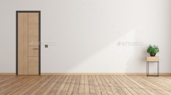 Empty room with closed door and houseplant - Stock Photo - Images