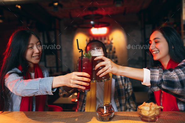 Group of friends watching sport match together. Concept of friendship, leisure activity, emotions - Stock Photo - Images