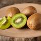 Fresh kiwi fruits on wood, clos-up - PhotoDune Item for Sale