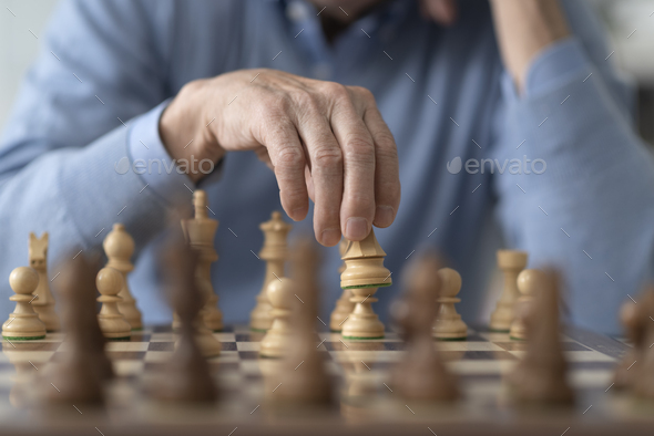 Elderly man playing chess at home - Stock Photo - Images