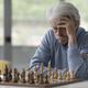 Focused senior man playing chess - PhotoDune Item for Sale