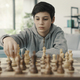 Boy playing chess at home - PhotoDune Item for Sale