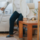 Old lady with a cane gets up from a chair from a room in a retirement home - PhotoDune Item for Sale