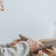 Grey elderly man hands a book to a senior friend lying on a hospital bed - PhotoDune Item for Sale