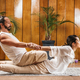Thai Yoga Massage - Stretching Female Patient in the Cobra Position - PhotoDune Item for Sale