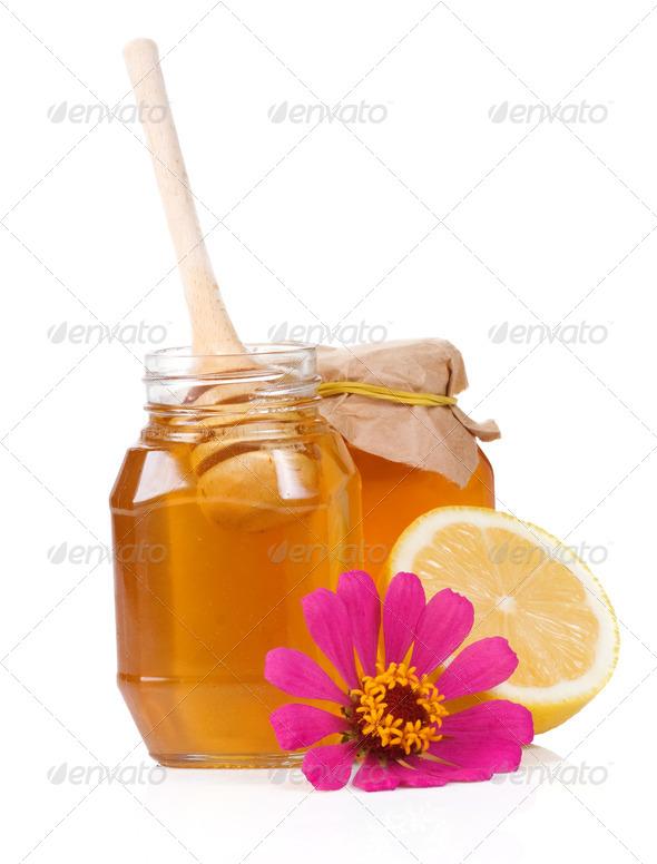 lemon, flower and honey isolated on white - Stock Photo - Images
