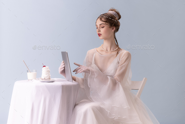 Young woman in art action isolated on white background. Retro style, comparison of eras concept - Stock Photo - Images