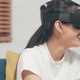Asian teenager woman using glasses virtual reality simulator playing video games in living room. - PhotoDune Item for Sale