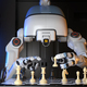 Robot playing a game of chess - PhotoDune Item for Sale