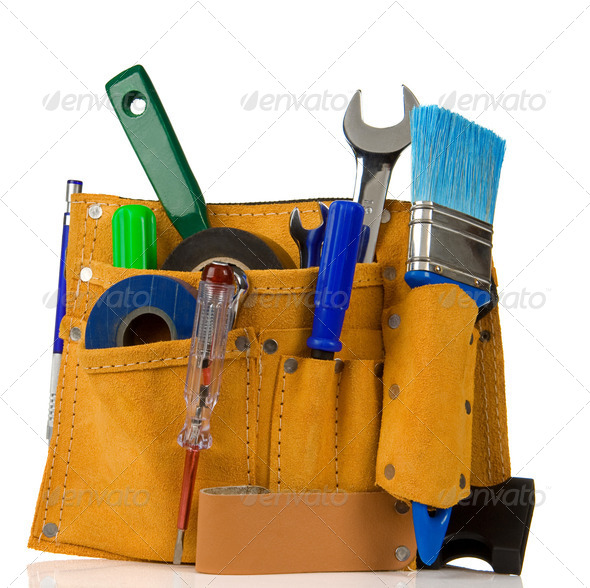 tools and instruments in leathern belt - Stock Photo - Images