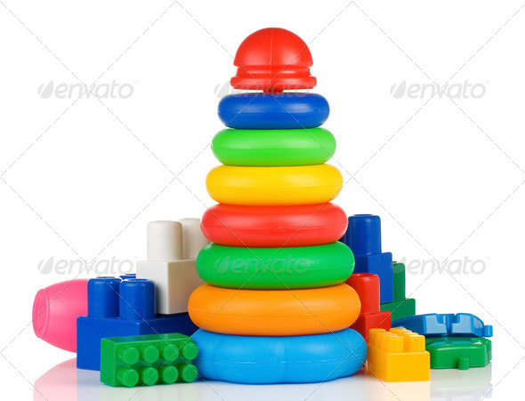 colorful plastic toys and bricks on white - Stock Photo - Images