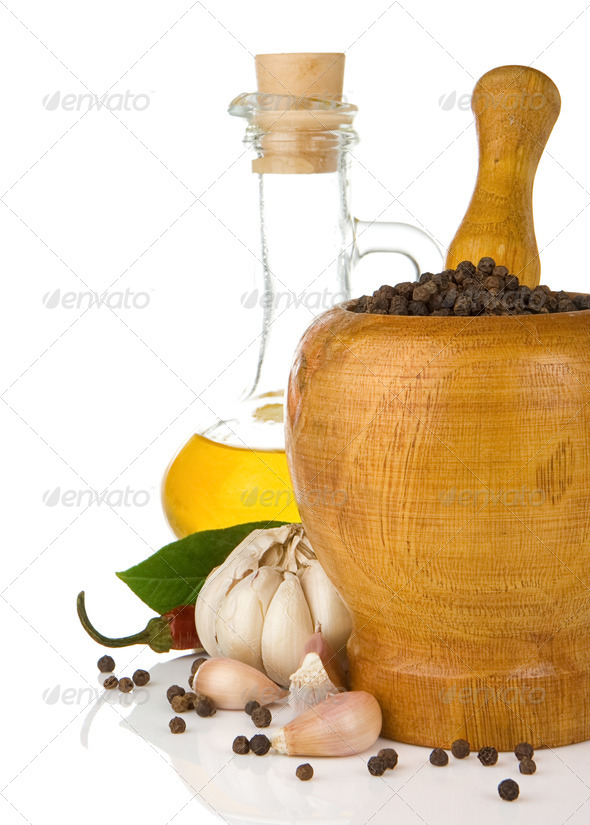 garlic, onion and pepper in mortar and pestle - Stock Photo - Images