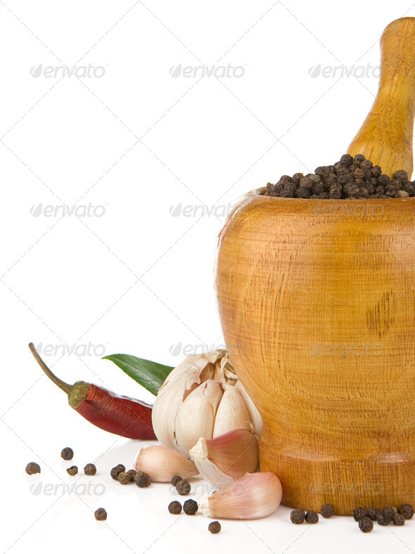 garlic, onion and pepper in mortar and pestle isolated on white - Stock Photo - Images
