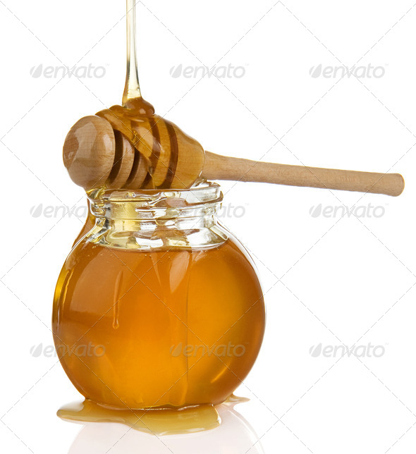 glass pot full of honey and stick on white - Stock Photo - Images