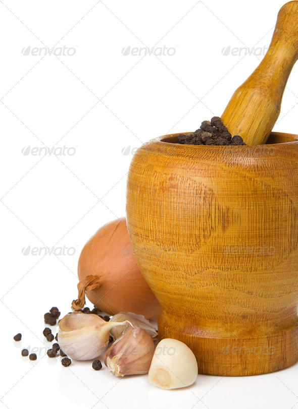 garlic, onion, pepper in mortar and pestle on white - Stock Photo - Images
