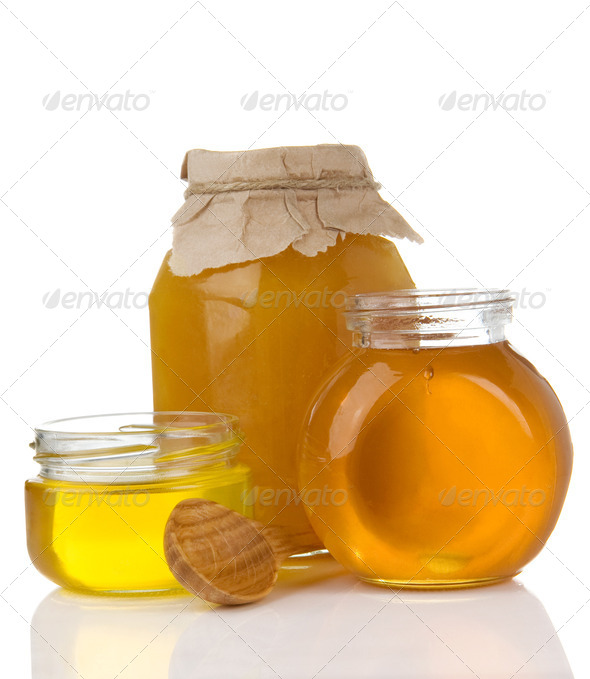 pot of honey and stick isolated on white - Stock Photo - Images