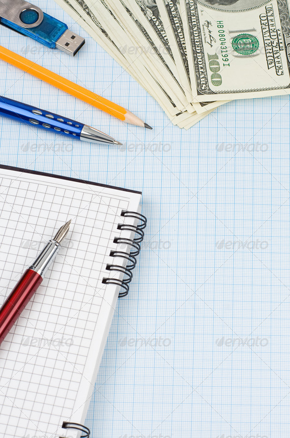school accessories and notebook on graph grid paper - Stock Photo - Images