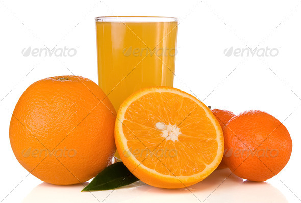 juice in glass and oranges on white - Stock Photo - Images