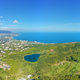 Spring mountain lake in forest, and sea shore. - PhotoDune Item for Sale