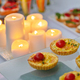 Candle and snack on table - PhotoDune Item for Sale