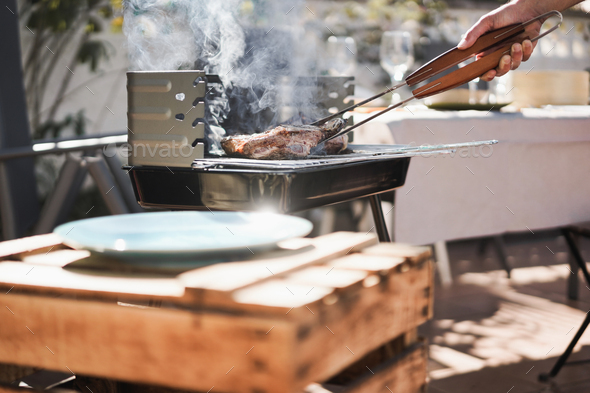 Chef cooking meat at barbecue home dinner outdoor at backyard garden - Stock Photo - Images