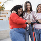 Happy latin girls having fun with electric scooter outdoor in city - Main focus on black woman face - PhotoDune Item for Sale