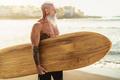Fitness senior having fun surfing at sunset time - PhotoDune Item for Sale