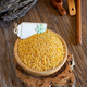 bamboo bowl with yellow lentils on wooden table - PhotoDune Item for Sale