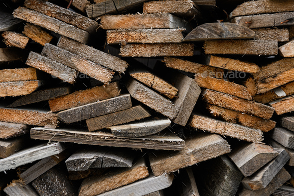 Piles of old wooden boards in the sawmill, planking. Wood timber stack of wooden blanks construction - Stock Photo - Images