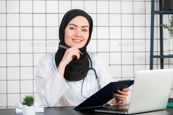 Portrait Of Smiling Muslim Female Doctor at her office - Stock Photo - Images