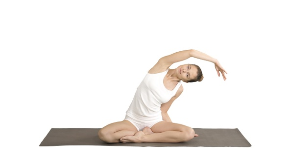 Beautiful woman practice yoga in lotus pose stretching by ...