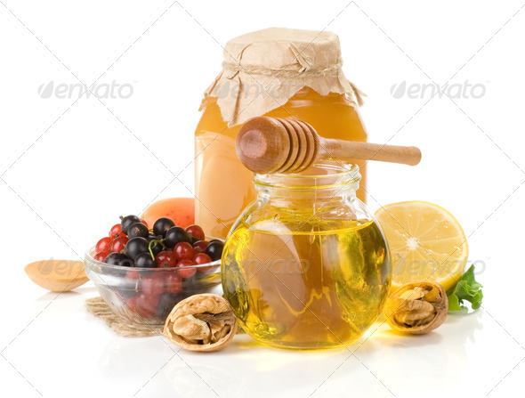 glass jar full of honey, lemon and berry - Stock Photo - Images