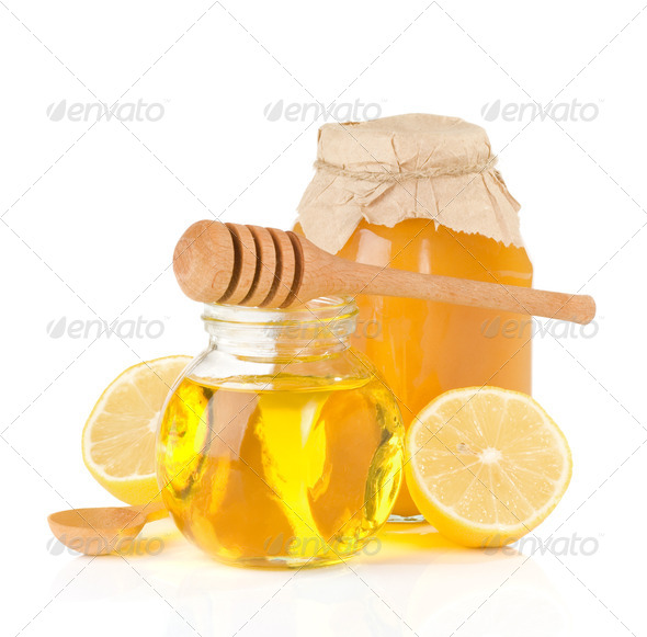jar full of honey and lemon - Stock Photo - Images