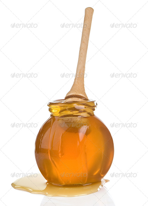 glass jar full of honey and stick - Stock Photo - Images