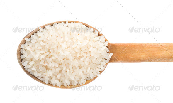 rice grain in wooden spoon - Stock Photo - Images