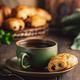 Green cup of tea with mini chocolate bun - PhotoDune Item for Sale