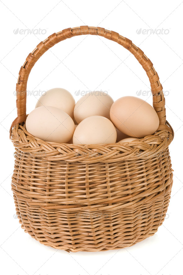 eggs and basket isolated on white - Stock Photo - Images