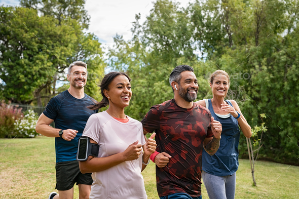 Mature people jogging in park - Stock Photo - Images