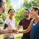 Group of active mature friends in park stacking hands after workout - PhotoDune Item for Sale