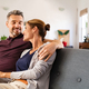 Mature couple in love sitting on couch - PhotoDune Item for Sale