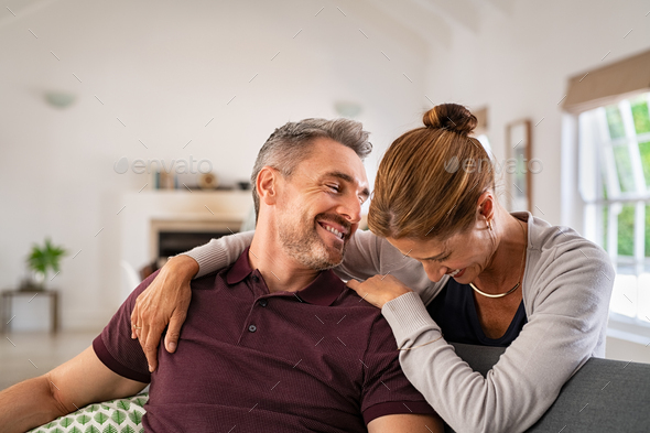 Laughing mature woman embracing man and having fun together - Stock Photo - Images