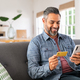 Mixed race man paying online on mobile phone - PhotoDune Item for Sale