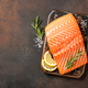 Fresh salmon fillet on wooden board and spices for cooking - PhotoDune Item for Sale