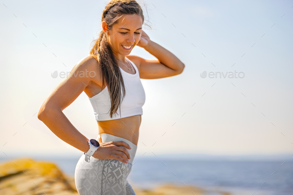 Confident Slim Woman Standing With Hand On Hip - Stock Photo - Images