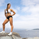 Athletic Woman Looking Away While Standing On Rock - PhotoDune Item for Sale