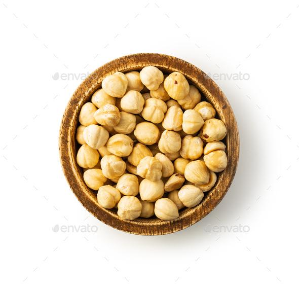 Peeled roasted hazelnuts in wooden bowl. - Stock Photo - Images