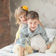 Brother and sister playing with teddy bear in bed - PhotoDune Item for Sale