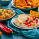 Homemade spicy humus with pomegranate seeds, chilli and chickpeas tortilla chips - PhotoDune Item for Sale