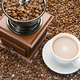 Old coffee grinder and a cup of coffee - PhotoDune Item for Sale