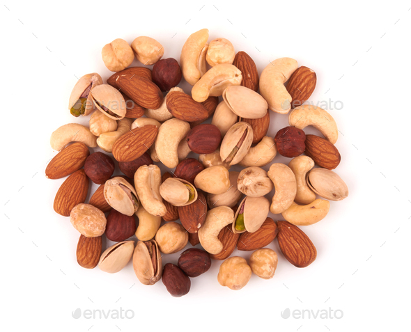 Heap of mixed nuts isolated on white background - Stock Photo - Images